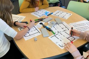 Students are coding a path for their Ozobot