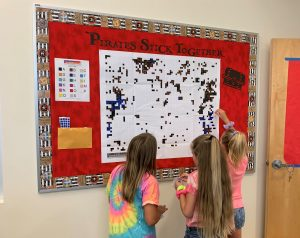 """Students work our our collaborative sticker art project - """"Pirates Stick Together"""""""